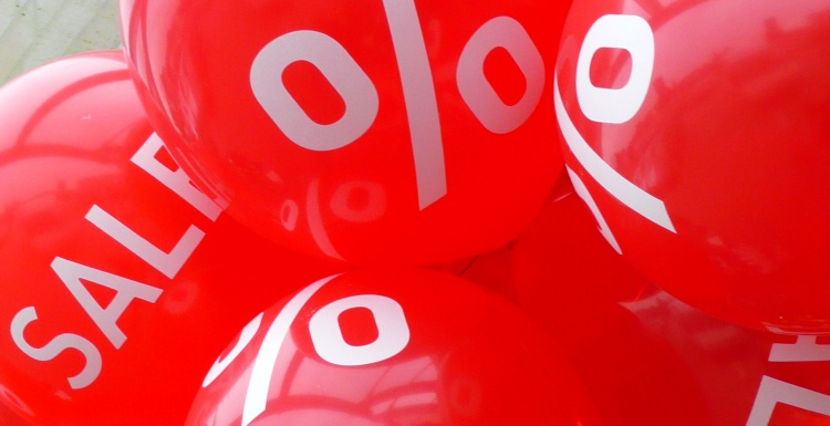 red balloons with sales text