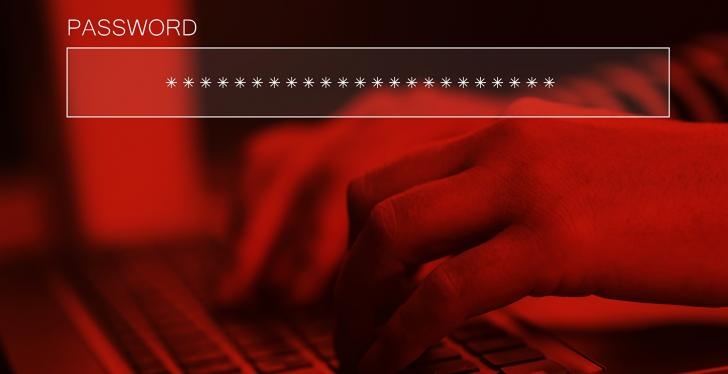 Fingers typing on a keyboard, picture colored in dark red; copyright:...