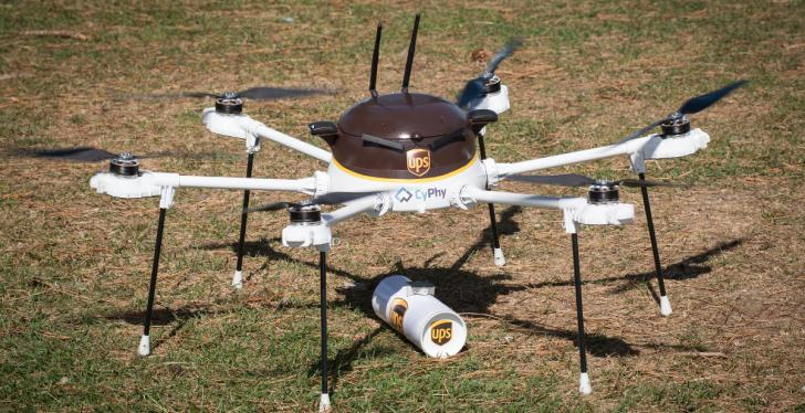 A delivery drone in UPS branding standing on grass; copyright: UPS...
