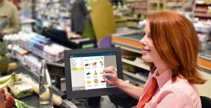 red-haired woman at checkout
