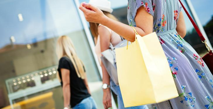 Women shopping with handbags on their arms