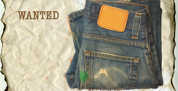 A blue jeans on a yellowed Wanted poster