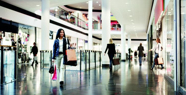 A woman walking through a shopping mall