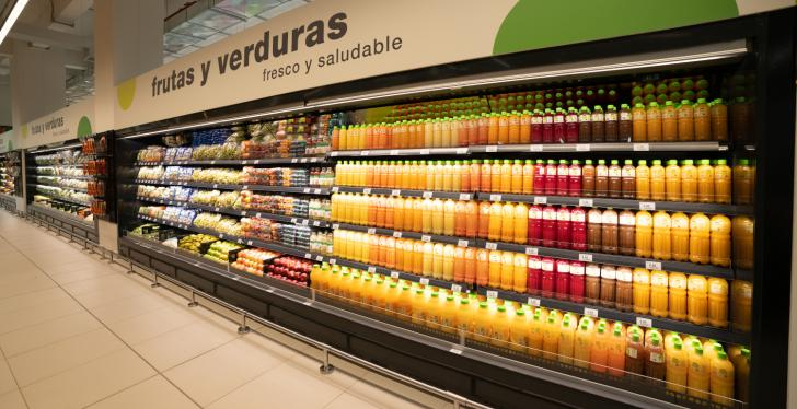A long refrigerated shelf in the supermarket with drink bottles...
