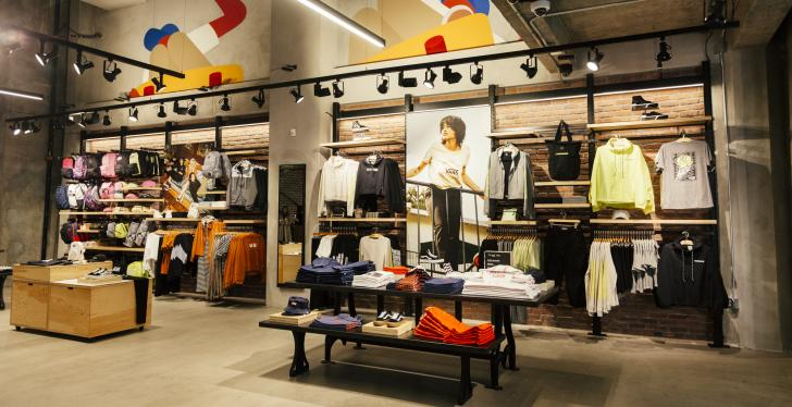 Inside of a modern fashion store with women's clothing; copyright: Vans...
