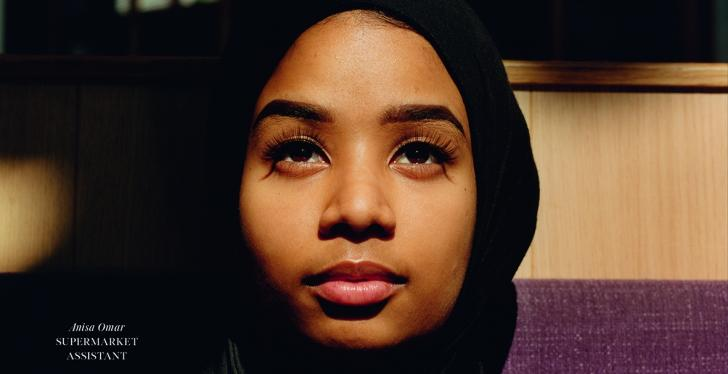 A young woman with black scarf