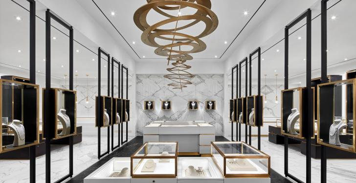 A jewelry store with white walls, golden decoration and black showcases...