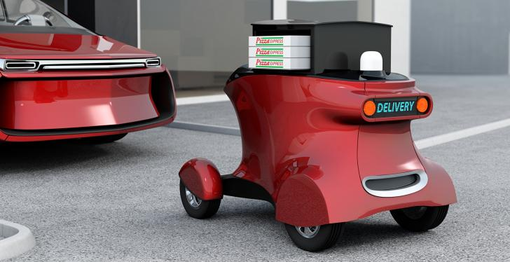 A red self driving delivery robot with pizza packages...