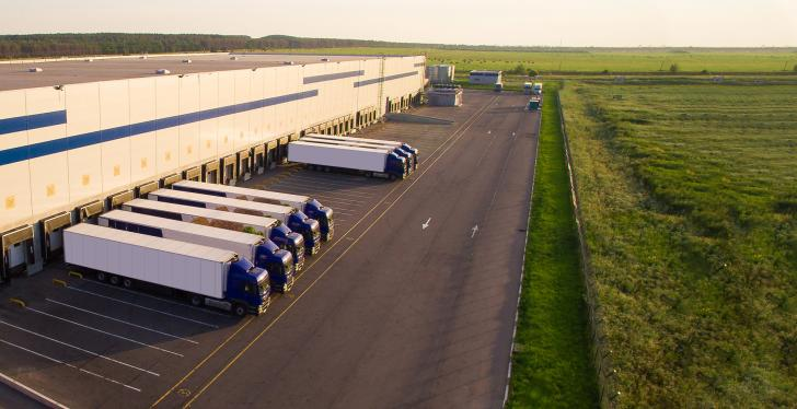A large greenfield shipping center with trucks