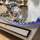 A sideboard in a store with shoes on it