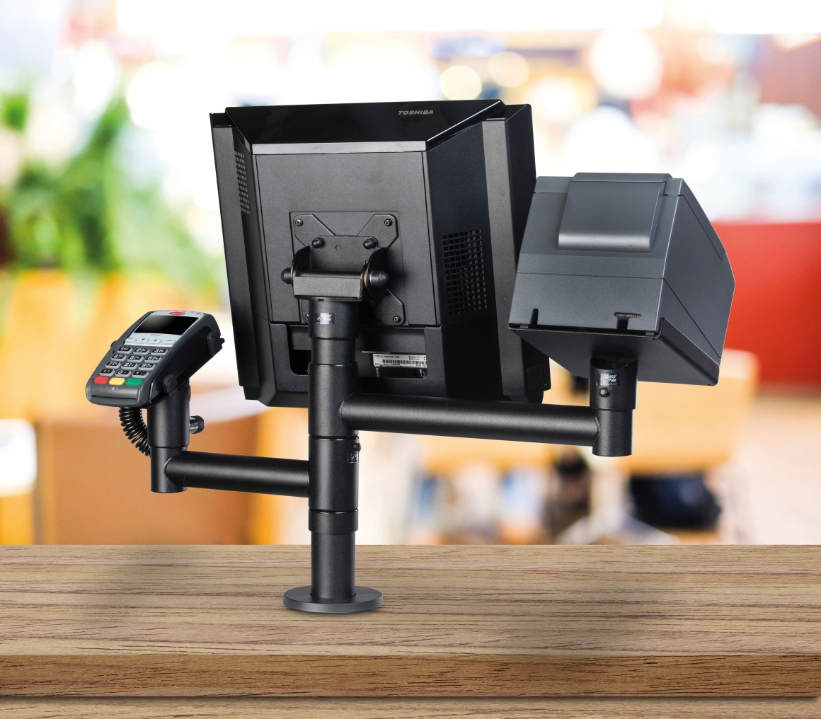 Photo: Several cash register devices mounted on rotating arms; copyright:...