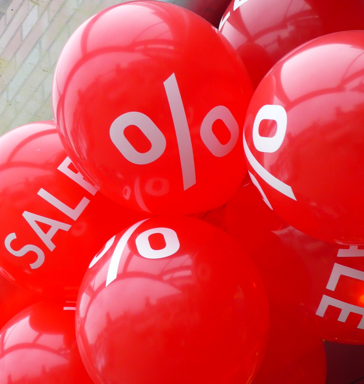 red balloons with sales promotion text