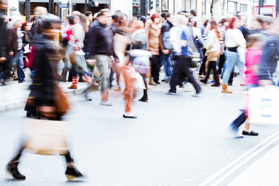 Photo: Busy street with pedestrians in an inner city; copyright: panthermedia....