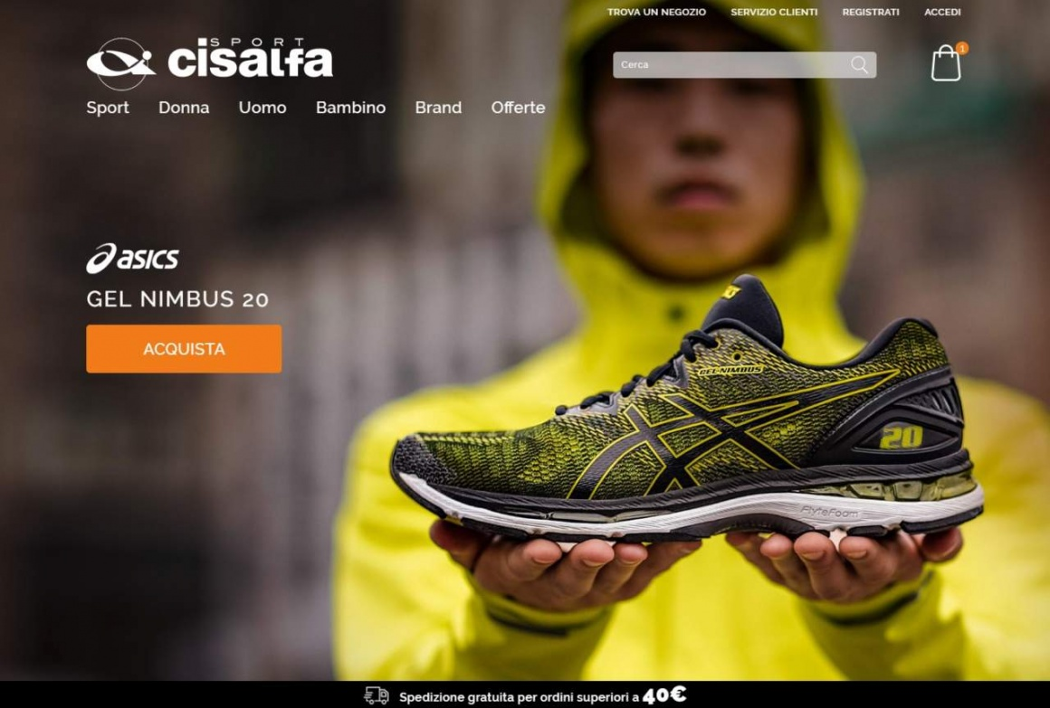 Screenshot of Website showing man holding a sports shoe...