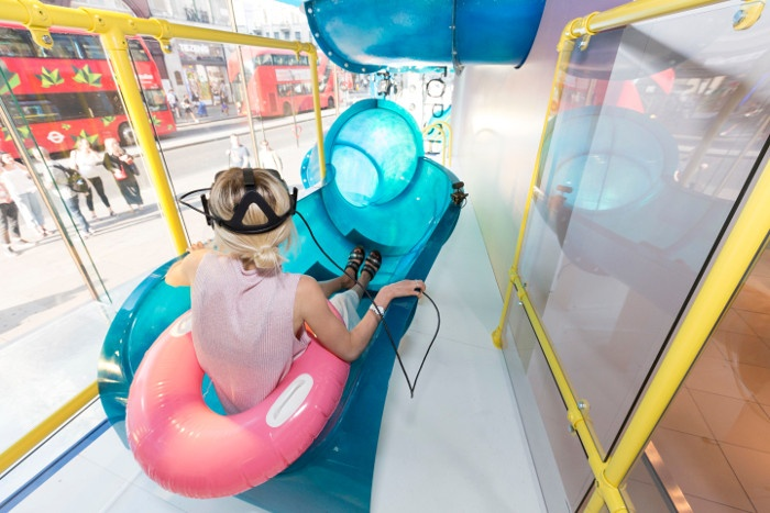 Woman in a slide with VR glasses; copyright: Topshop...