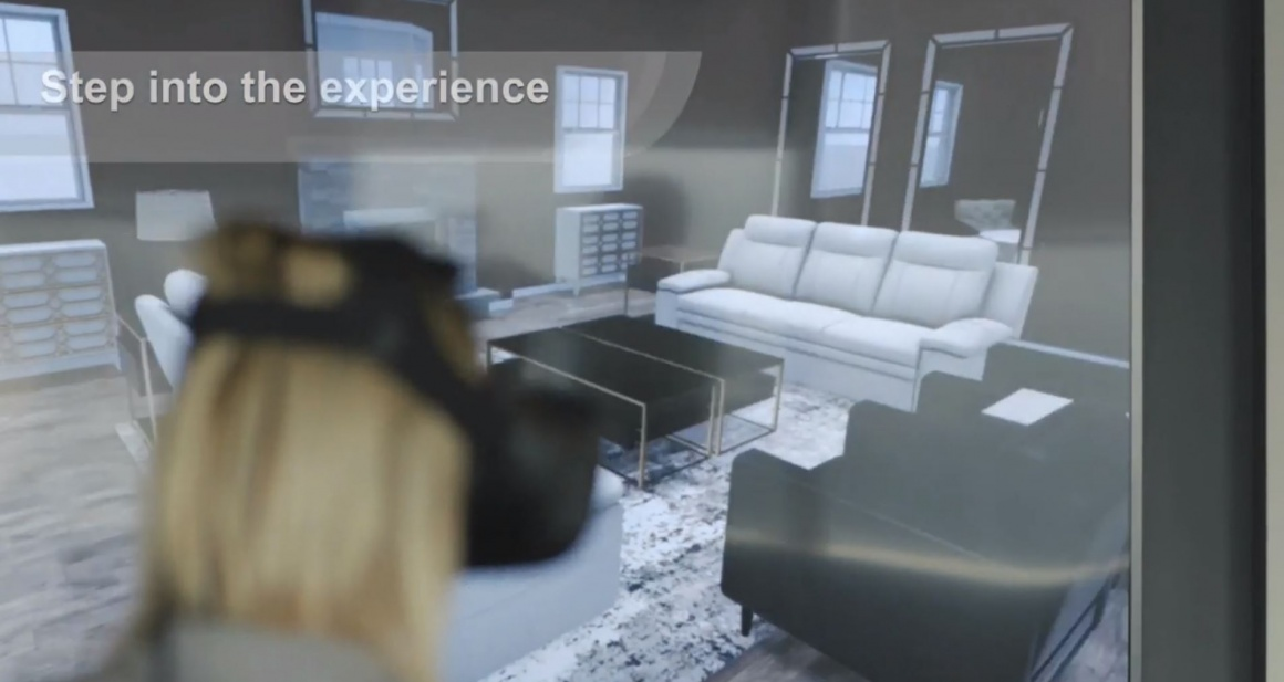 Woman with VR glasses looks at living room with furniture; copyright: Macys...
