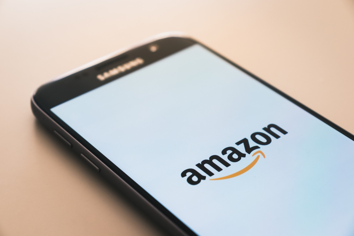 Smartphone with Amazon logo on screen