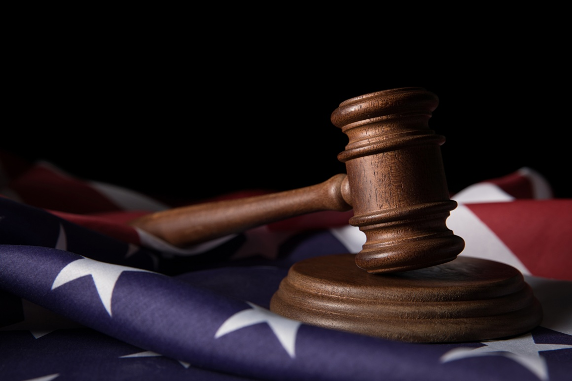 Judge's gavel on an American flag; copyright: panthermedia.net/MicEnin...