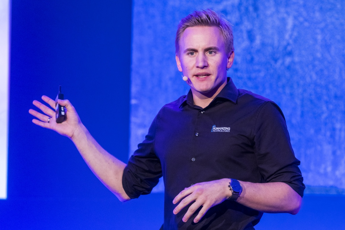 Picture of a young man giving a lecture; copyright: Humanizing Technologies GmbH...