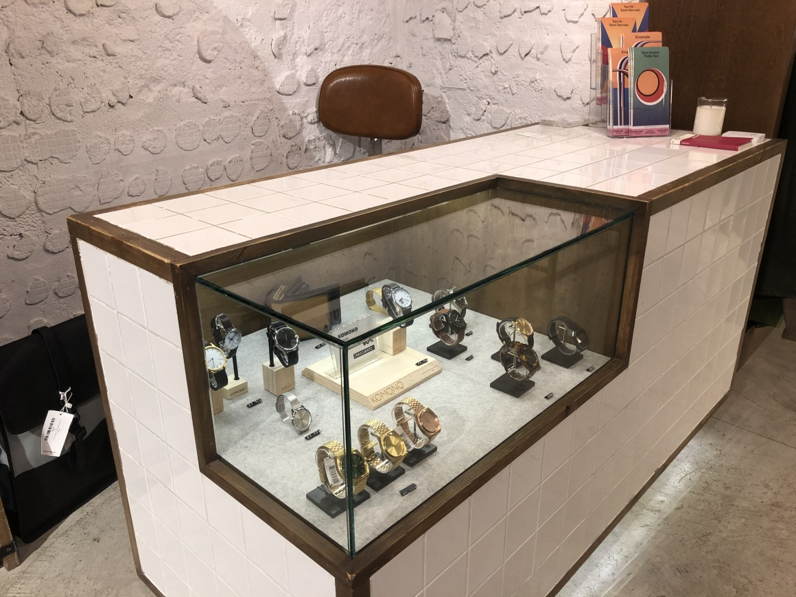 Checkout counter made of tiles with a built in glass case...