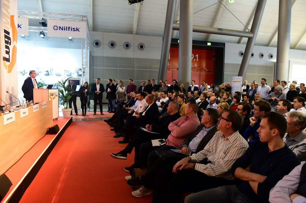 A stage and audience at LogiMAT