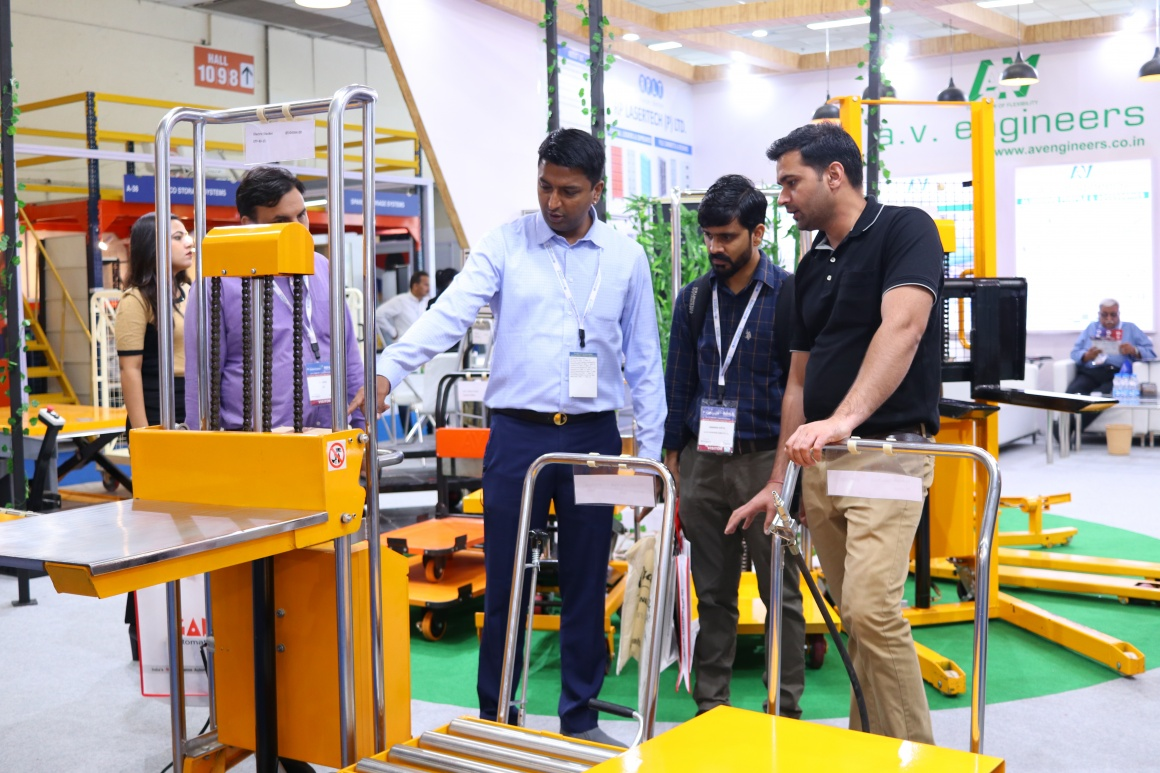 A guy showing a machine to two men